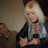 Tricia signs her new CD for fans